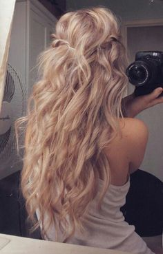 Beautiful long blonde hair. What I would do to have this back...and styled like this!