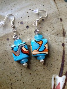Blue lampwork beads with brown stripes and by MarquisCreations