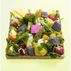 Baby vegetables pie: hazelnut-lemon sweet dough (pâte sablée), baby vegetables - pattypans, turnips with their tops, onions, carrots, red radishes, gourmand peas, and snacked-out tuna with poppy seeds, wasabi cream, from 9€