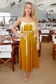 12 May Blake Lively arrived for the Café Society press junket wearing a golden-yellow, velvet sun dress.   - HarpersBAZAAR.co.uk