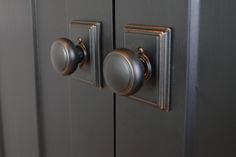 Choosing door hardware for a farmhouse. Newly Woodward blog. Door are painted:  Jet Black, Behr.   Finish:  Aged Bronze =  http://www.schlage.com/en/home/style/knob-lever-designs/andover-knob.html