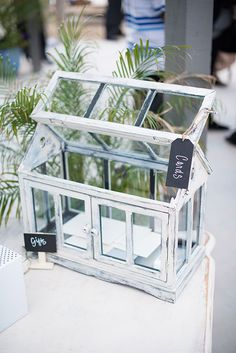 This old school vintage indoor greenhouse is perfect as a card box at a wedding for those who love the odd, the beautiful, and the botanical.