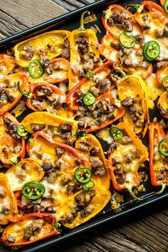 Low Carb Nachos Low Carb Nachos are an easy low carb snack filled with chopped steak/chicken/turkey/etc, lots of gooey, melted cheese, and fresh jalapenos, all baked into mini peppers. It's the perfect low carb snack for game day! Mini Sweet Peppers, Stuffed Mini Peppers, Recipes With Sweet Peppers, Keto Foods, Keto Snacks, Low Car Snacks, Healthy Low Carb Snacks, Healthy Protein, High Protein