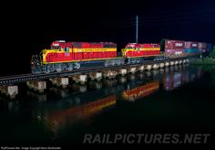 "A matched set of Florida East Coast ""Champion"" SD40-2s lead southbound train 121-23 over the San Sebastian River at St. Augustine at approximately 22:00 on November 23."