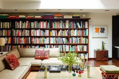 A painting by Jonathan Lasker hangs above a Japanese tansu chest in the living room; the bookcase is custom made, and the floors are wenge.