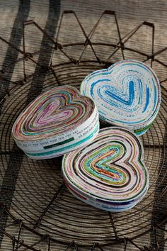 Recycled Paper Heart Box Adapted from a traditional basket-making technique, our Heart Box is made using recycled posters discarded from a printing company.  Fair Trade Artisans in Vietnam fold, wrap and glue the recycled papers to create each Recycled Paper Heart Box, each one unique.  This is up-cycling and re-purposing at is finest!