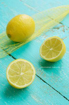 Fresh lemons on blue shabby background, via Flickr.