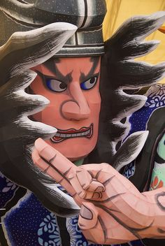 The float of Aomori Nebuta Festival, Japan.  I've been here!  And I got to help make one of these!  Pasting paper onto the wire frame.  Good times!