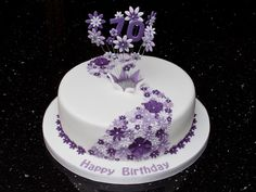 70th birthday cake with flower cascade and explosion.