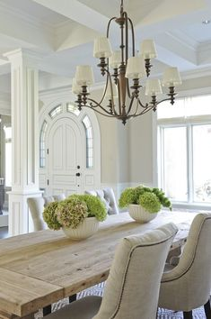beautiful white dining room; when you have interesting architecture and texture in your furnishings, you don't need a lot of color!