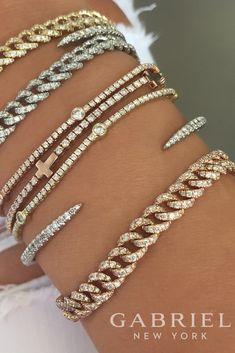 Gabriel - This gorgeous combination of bracelets are beyond words! We have 14k yellow gold, 14k rose gold, 14k white gold bangles and tennis bracelets. Find more beautiful diamond bracelets here-> https://www.gabrielny.com/products-fashion/bracelets