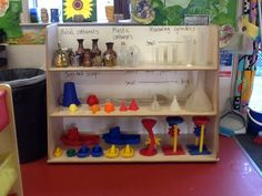 Reorganised water play resources with new shelving :)