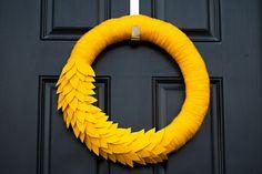 yarn wrapped wreaths   of this yarn wreath! Felt leaves were added to the yarn wrapped wreath ...