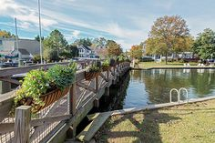 A pedestrian bridge in the quaint picturesque town of St. Michaels, on Maryland's Eastern Shore. The end of October shows the signs of Autumn colors in the trees while planters along the railing of the walk-bridge has lush green plants.