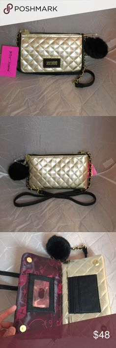 "Betsey Johnson Golden Crossbody wallet Measures 5""x 8"". This gorgeous bag is roomy. Front: Magnetic snap closure. 3 credit card slots and 1 ID window. 1 bill slot. Back: Zipper pocket. Easily fits larger phone such as iPhone 6 Plus. The Black Pompom key chain is detachable. Betsey Johnson Bags Crossbody Bags"