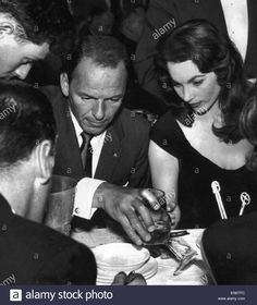 Frank Sinatra escorted Shirley Ann Field to Pigalle in the company of Mr and Mrs Peter lawford, Mr and Mrs George Stevens the director and Vic Damone. The party can be seen here enjoy a after show supper. 4th June 1958 Stock Photo