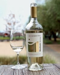 Can't go wrong with a glass of our Sauvignon Blanc and a nice view from the tasting room porch.