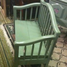 This cute little sage bench is made from a child youth bed.