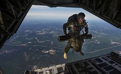 A U.S. Air Force combat controller jumps out of an MC-130J Combat Shadow II during Emerald Warrior 2015 at Hurlburt Field, Fla., April 22, 2015. Emerald Warrior is the Department of Defense's only irregular warfare exercise, allowing joint and combined partners to train together and prepare for real-world contingency operations. (U.S. Air Force photo by Staff Sgt. Douglas Ellis/Released)