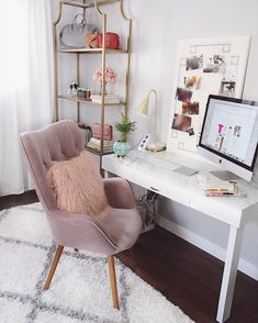 Small chic at home desk space with cosy interiors and decorative shelves.