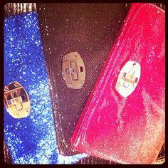 Armani Exchange glitter clutches.
