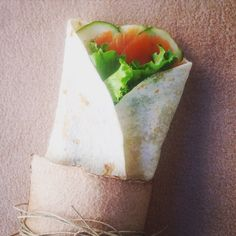 Smoked salmon wrap; with cucumber, salad, tomato and lime sauce.