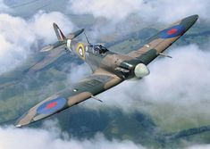 Flying high: The Spitfire in the air soaring through the clouds