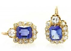 These turn of the century cluster style earrings are crafted in 18 karat yellow gold and feature 4.50 carats total of unheated sapphires surrounded by 2 carats total of Old Mine cut diamonds.
