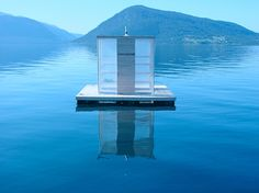 This floating sauna in Norway is anchored in the middle of a fjord with the winter sun coming in through transparent walls. Access to the sauna is by boat and users can descend into the fjord water for an icy dip through a hole in the floor. Finnish Sauna, World Photo, Boat Building, Around The Worlds, Exterior, Wellness, Lap Pools, Indoor Pools, Backyard Pools