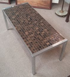 Vintage 1970s Chrome & Ceramic Tile Coffee Table. Length measures 41.5 inches, Width 18 inches, Height 16 inches.
