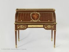 A desk made by Riesener for Marie Antoinette.  In 1784 Marie Antoinette had a small apartment in the Tuileries refurbished in the latest fashion. The royal cabinetmaker, Jean-Henri Riesener, delivered several pieces of furniture for the bedroom, including a chest of drawers, a bedside table, and a toilette table (now in the Musée National du Château de Versailles), as well as a rolltop desk for the closet.