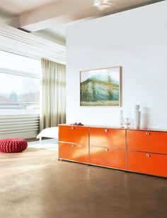 Modern USM Haller sideboard in pure orange in the living room.