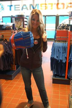 All items available at the Islanders Team Store at Nassau Coliseum... Women's Tank Top - 26.86; Stefani Full Zip Burnout - 34.53; Game On Glove - 34.98; 1255 Hempstead Turnpike, Uniondale, NY 11553; Call: 516-501-6726/6728; Email: Merchandise (@) newyorkislanders.com. As modeled by a member of the 2012-13 Islanders Academy Mortgage Ice Girls.