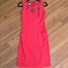 Stunning coral pencil dress Has thee most gorgeous fit ive ever seen in my life! Stunning dress will cool stud accents. Absolutely amazing. Will fit size 4-6 AGB Dresses Midi