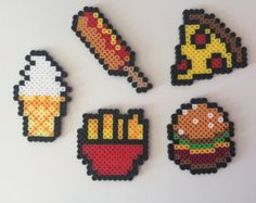Made with high quality Perler beads, bringing your love of food to life with these detailed figurines. Pizza: 3 x 3 Fries: 3 x 3 Cornd . Perler Bead Designs, Easy Perler Bead Patterns, Melty Bead Patterns, Perler Bead Templates, Hama Beads Design, Diy Perler Beads, Perler Bead Art, Beading Patterns, Peyote Patterns