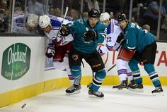 San Jose Sharks defenseman Jason Demers tracks down the loose puck during the second period (Oct. 8, 2013).