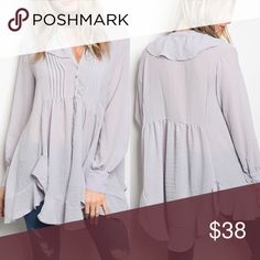 Coming Soon! Lilac Blouse Long sleeve relaxed fit tunic top that features a v-neckline and a handkerchief hemline. 100% Polyester. Tops