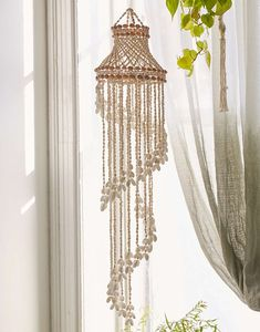 Hanging mobile in a tiered design, made from natural sea shells. Each mobile is made from unique shells and may vary slightly from the picture, giving you a one-of-a-kind piece. Macrame Design, Macrame Art, Macrame Projects, Decoration, Art Decor, Shell Chandelier, Macrame Curtain, Macrame Patterns, Home And Deco