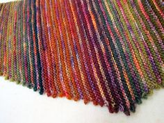 Scarf...Simple addition: cast on two, turn, bind off two. Bakus