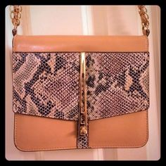 "✨PM Editor Pick!✨River Island Snake Lady Crossbody Cute find from ASOS! Faux nude leather and faux textured snakeskin crossbody with gold turnlock closure. Quite roomy too since the base expands to about 2.5"" when you put stuff in it. I tied a knot in the strap because it is too long for my taste. Price reflects the pre-loved condition! ASOS Bags Crossbody Bags"