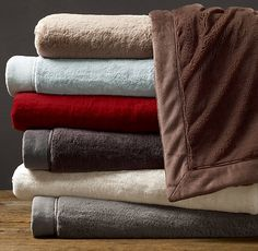 We have several Restoration Hardware plush throws $39.00 hanging around the house.  Love!  Make great gifts too.