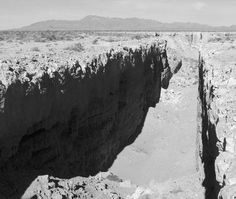 Earthwork, Double Negative, 1970, Michael Heizer. There's a map at this website