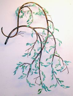 Willow branch maybe instead of a tree of life tat, maybe with 2 small birds for my son and myself...