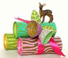 Super cute yule log gift boxes made out of toilet paper tubes and egg cartons.