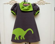 This gorgeous charcoal gray, cotton/lycra jersey knit dress features short puffed sleeves with a contrast band of lime green. The asymmetrical lime green collar gives it a lovely pop of color