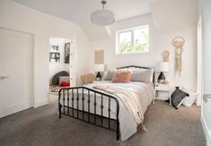 Guest bedroom with a single window and metal bed frame, with a small room attached for other uses. Modern Farmhouse Exterior, Modern Farmhouse Style, Farmhouse Plans, All Family, Home And Family, Custom Bunk Beds, Secret Rooms, Built In Bookcase, Cozy House