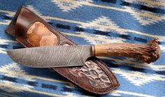 """Large 11"""" Damascus Bowie Knife. Elk antler crown handle with copper ferrule. The complimentary sheath had cut out inlays of air chased copper ( made by Bud) and copperhead snake skin. http://www.etsy.com/shop/misstudy Out of the Ashes Forge, Har mony N.C."""