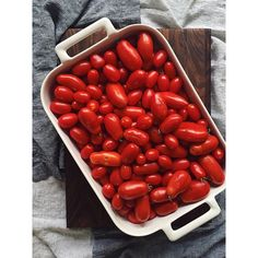 I've been under the weather this week - so clearly the only way to combat feeling ill on Labor Day weekend is to have your mom harvest and deliver an insane amount of San Marzano  Juliet tomatoes from her backyard to your door. #summer #laborday #pomodori #harvest #september #kitchengarden by @saragasbarra