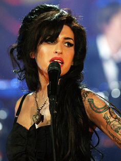AMY WINEHOUSE DIED JULY 23  AGE 27  SHE SHOULD'VE WENT TO REHAB AND STAYED THERE  DID ANYBODY NOT SEE THIS COMING HER CAMP SHOULD HAVE STEPPED IN AND MADE HER HELP HERSELF     GRAMMY WINNER  LONG GONE