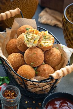Corn cheese balls served in basket with once ball cut open to show the texture within, ketchup on the side. Cheese Corn Balls Recipe, Corn Cheese, Cheese Ball Recipes, Cheese Sauce, Vegetarian Snacks, Savory Snacks, Snack Recipes, Cooking Recipes, Tasty Snacks